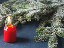 Dark christmas background with red candle Royalty Free Stock Photography