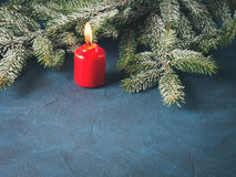 Dark christmas background with red candle Royalty Free Stock Photo