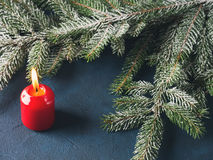 Dark christmas background with red candle Stock Images