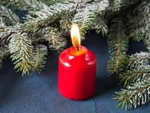 Dark christmas background with red candle Stock Image