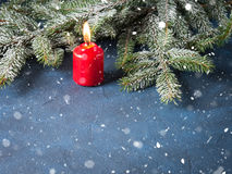 Dark christmas background with red candle Stock Photography