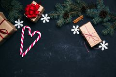 Dark christmas background with xmas decoration gift box balls to. Ys and christmas candy cane festive concept top view Stock Photography