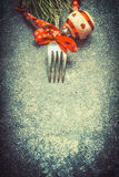 Dark Christmas food background with fork and red festive holiday decorations, top view. Frame Royalty Free Stock Image