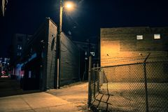 Dark city alley at night. Dark and eerie urban city alley at night Royalty Free Stock Photography