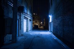 Dark city alley at night. Dark and eerie urban city alley at night Stock Images