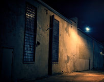 Dark City Alley at Night with Moon Royalty Free Stock Photography
