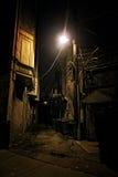 Dark City Alley. Dark Urban Alley at Night Stock Photo