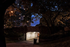 Dark City Bridge Underpass Sidewalk at Night Stock Photo