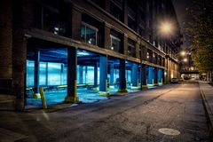 Dark city downtown street road and alley at night. Stock Photo