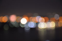 Dark city night light blur bokeh ; defocused background. Royalty Free Stock Image