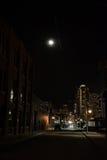 Dark City Street at Night with Moon. Dark Urban City Street at Night with Moon Royalty Free Stock Image