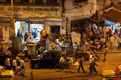 Dark city traffic blurred in motion at late evening on crowded streets in Kolkata Royalty Free Stock Image