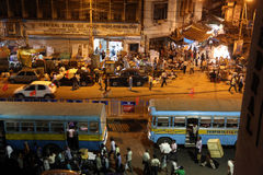 Dark city traffic blurred in motion at late evening on crowded streets in Kolkata Stock Images