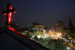 Dark city traffic blurred in motion at late evening on crowded streets in Kolkata Stock Photo