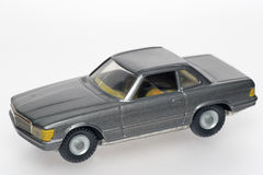 Dark Classic Mercedes toy cars. One of the many thousand  toys my brother is collecting. Tin Mercedes Stock Image