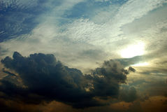 Dark cloud. In the sky with the sun Royalty Free Stock Image