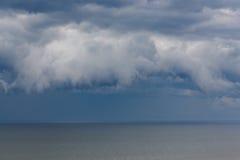 Dark cloud asperatus over the sea Stock Photos