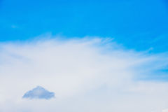 Dark cloud on the horizon. Small single dark cloud on the midday blue summer sky Royalty Free Stock Images
