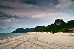Dark Cloud over Beach and Mountain Royalty Free Stock Photos