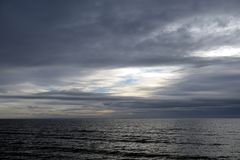 Dark cloud over the sea. Dark cloud over the Gulf of Finland of Baltic Sea, Russia stock image