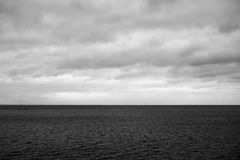 Dark cloud over sea. Dark cloud over the Gulf of Finland of Baltic Sea, Russia. Black and white stock images
