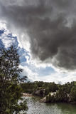 Dark Cloud Over Quarry. Elora Quarry with storm clouds above Royalty Free Stock Photography