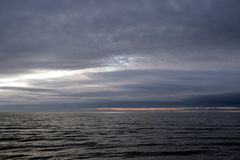 Dark cloud over sea. Dark cloud over the Gulf of Finland of Baltic Sea stock photo