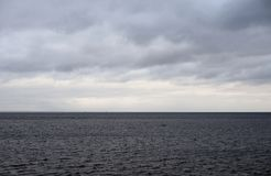 Dark cloud over sea. Dark cloud over the Gulf of Finland of Baltic Sea, Russia royalty free stock photography