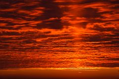 Dark cloud on red sky Stock Photo