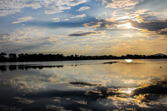 Dark cloud. Reflection with lake stock photo