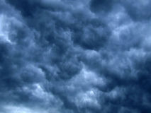 Dark clouds. Abstract picture of the dark stormy clouds Stock Photos