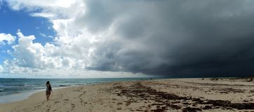 Dark Clouds. Panoramic view of heavy dark clouds over Grand Turk island beach, Turks & Caicos Royalty Free Stock Photo