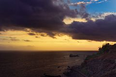 Dark clouds above coastline at sunset. Portuguese island of Madeira stock photos