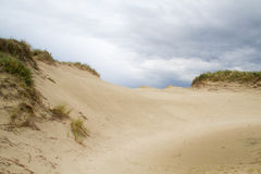 Dark clouds above a dune valley Royalty Free Stock Image
