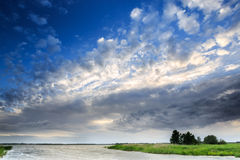 Dark clouds above a lake Stock Photography