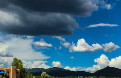 Dark clouds ahead of thunderstorm over mountians outside of Santa Fe New Mexico. Dark clouds ahead of a thunderstorm over mountians outside of Santa Fe New stock photography