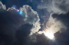 Dark clouds in bad weather. With sunshine stock photos