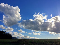 Dark clouds on a blue sky Stock Images