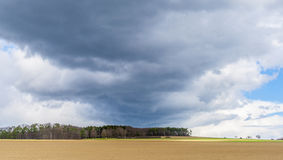 Dark clouds and blue sky Stock Images