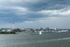 Dark clouds and brisk wind on early summer day in New Bedford Royalty Free Stock Photography