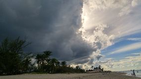 Dark clouds on Caribbean sky royalty free stock photography