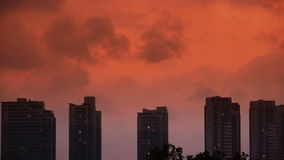 Dark clouds cover sky at evening,building high-rise,House silhouette,sunrise,sunset. stock video footage