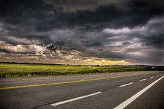 Dark Clouds. And sunset at the background Royalty Free Stock Photography