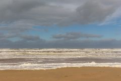 Dark clouds Egmond aan Zee, The Netherlands. Dark clouds over the Nort Sea in Egmond aan Zee royalty free stock photo