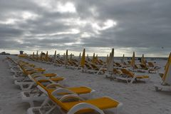Ruined vacation rainy days in Clearwater beach Florida. Dark Clouds and empty chair show ruined vacation due to rainy days in Clearwater beach Florida stock image