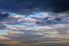 Dark clouds in the evening sky. Dramatic photo. Background for title, picture for blog. Horizontal image royalty free stock images