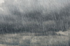 Dark clouds with falling rain Stock Photos