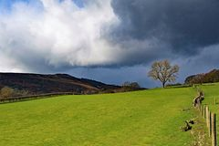 Dark clouds gather over Win Hill, in Derbyshire. Taken to capture the rich colourations and varied terrain, surrounding Bamford, in the Peak District royalty free stock images