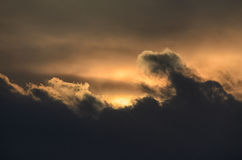 Dark clouds on a golden sky Royalty Free Stock Images