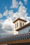 Dark clouds above mosque in Albaicin, Granada. Dark clouds hanging above mosque in Albaicin, Granada, Andalusia, Spain stock photo
